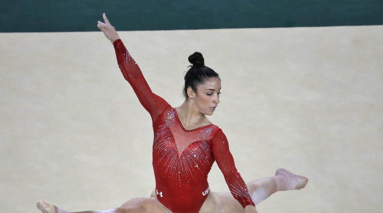 United States' Aly Raisman performs on the floor during the artistic gymnastics women's individual all-around final at the 2016 Summer Olympics in Rio de Janeiro, Brazil, Thursday, Aug. 11, 2016. (AP Photo/Julio Cortez)