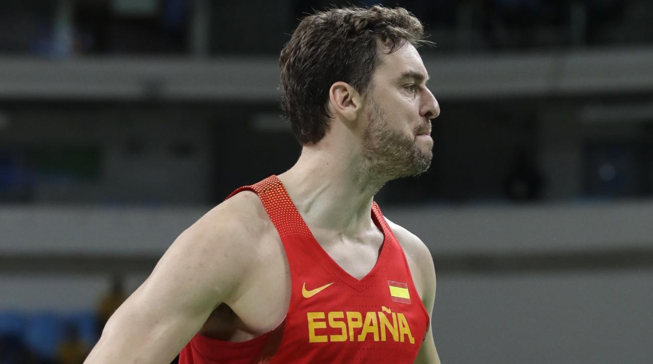 Spain's Pau Gasol (4) reacts after making a basket during a basketball game against Nigeria at the 2016 Summer Olympics in Rio de Janeiro, Brazil, Thursday, Aug. 11, 2016. (AP Photo/Charlie Neibergall)