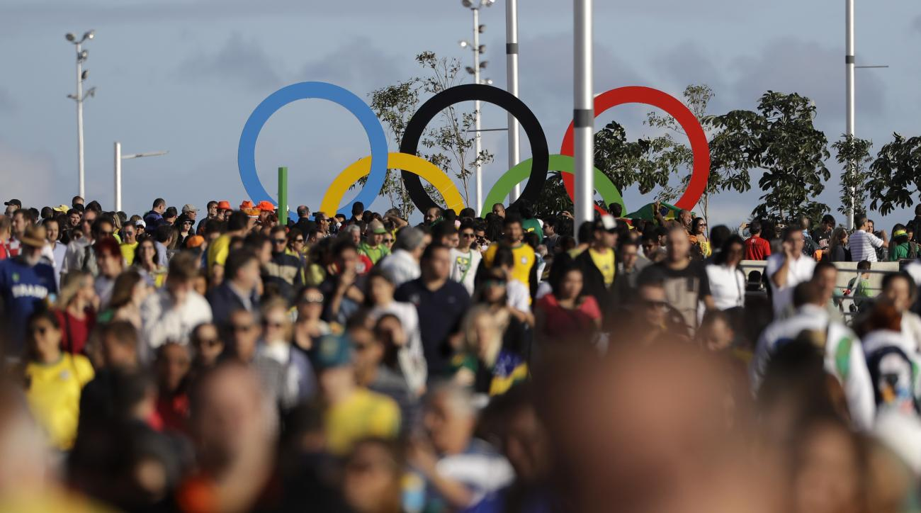People crowd at the Olympic Park during the 2016 Summer Olympics in Rio de Janeiro, Brazil, Thursday, Aug. 11, 2016. (AP Photo/Jae C. Hong)