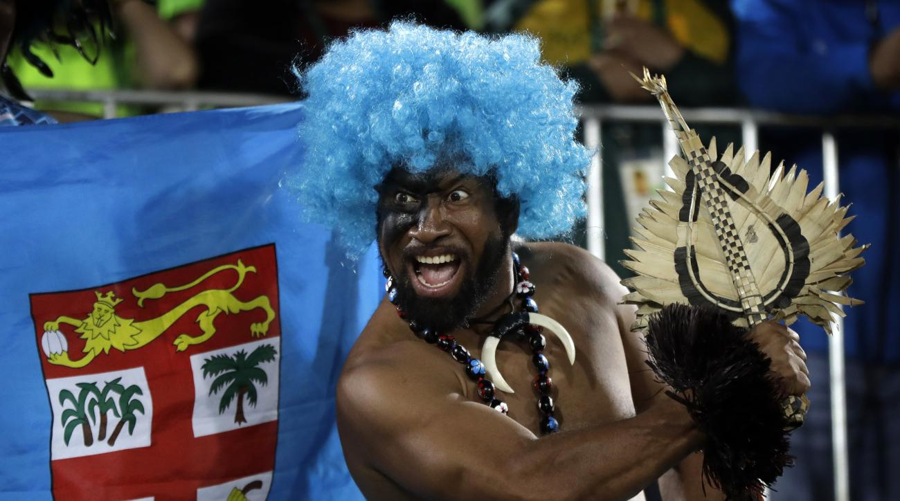A Fiji fan celebrates his country's gold medal victory over Britain in the mens rugby sevens at the 2016 Summer Olympics in Rio de Janeiro, Brazil, Thursday, Aug. 11, 2016. (AP Photo/Robert F. Bukaty)