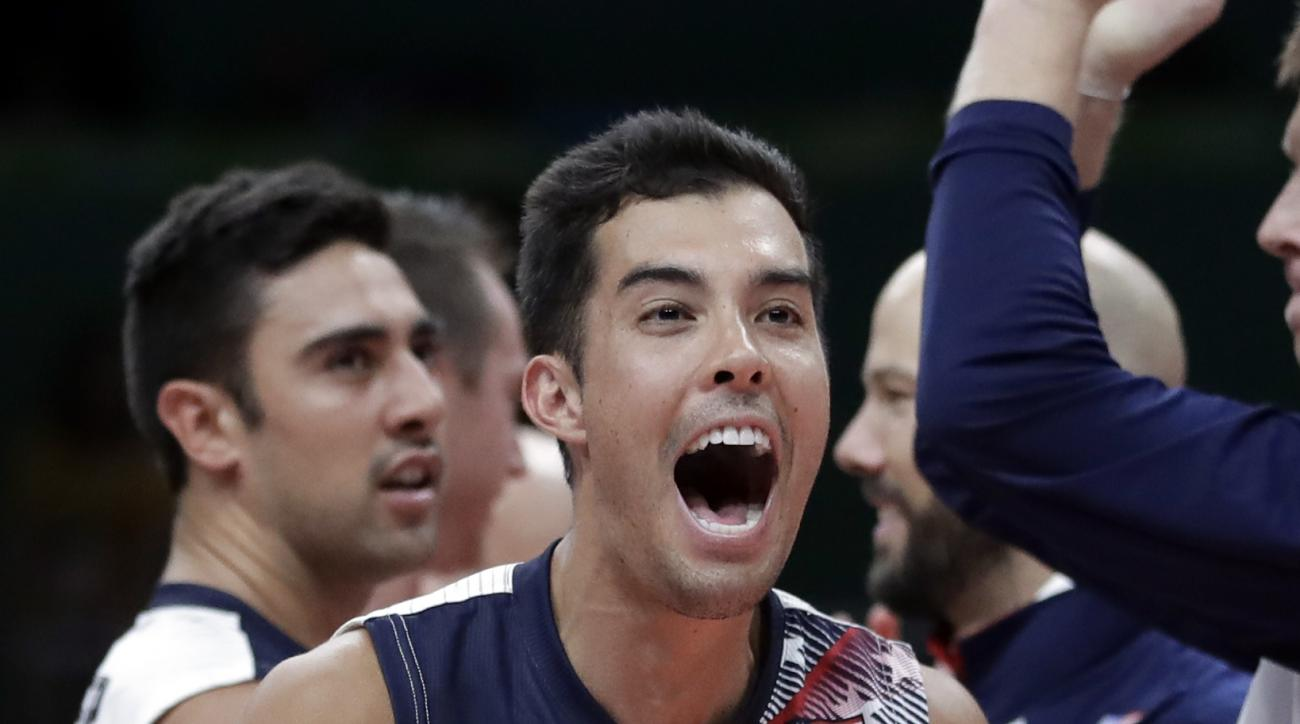 United States' Kawika Shoji celebrates with teammates after defeating Brazil in a men's preliminary volleyball match at the 2016 Summer Olympics in Rio de Janeiro, Brazil, Friday, Aug. 12, 2016. (AP Photo/Jeff Roberson)