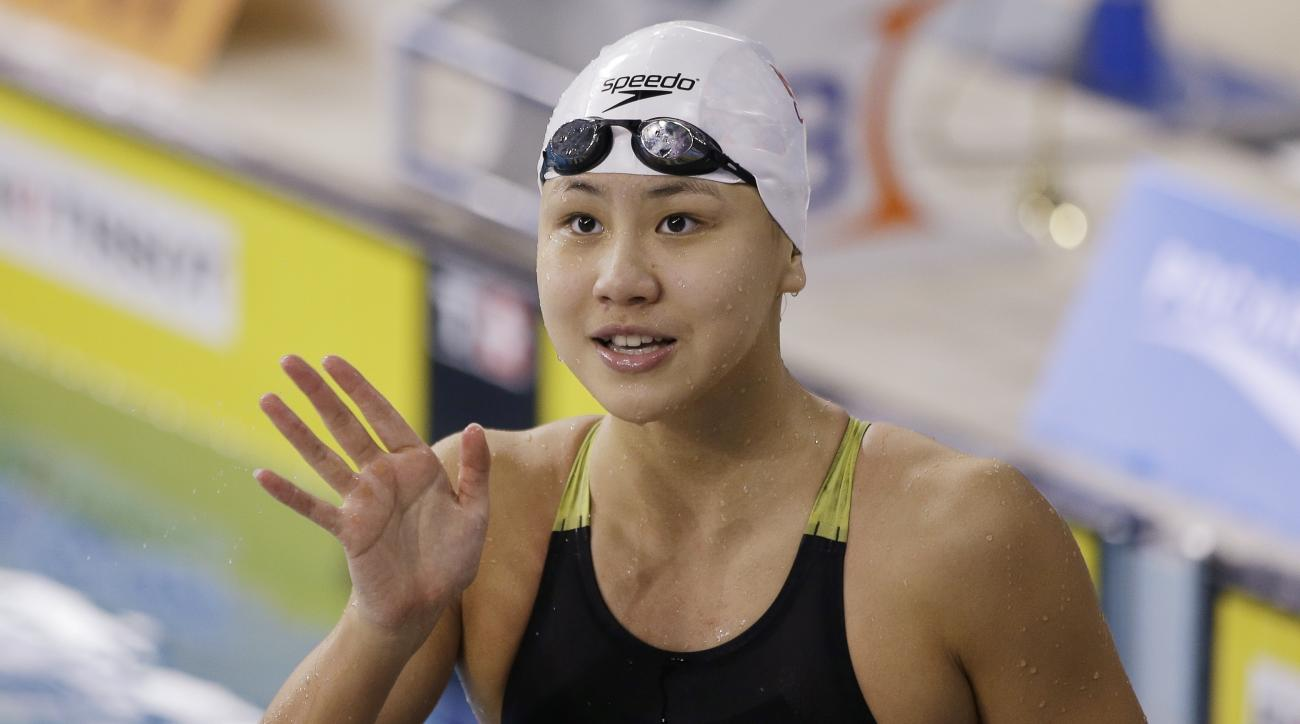 FILE - In this Sept. 26, 2014 file photo, China's Chen Xinyi reacts after winning the women's 50m freestyle swimming final at the 17th Asian Games in Incheon, South Korea. The Chinese Swimming Association said Chen Xinyi tested positive for the substance