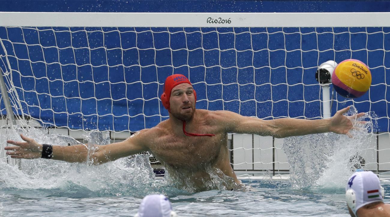 Hungary's goalkeeper Viktor Nagy failed to stop a ball during a preliminary men's water polo match against Japan at the 2016 Summer Olympics in Rio de Janeiro, Brazil, Friday, Aug. 12, 2016. (AP Photo/Eduardo Verdugo)