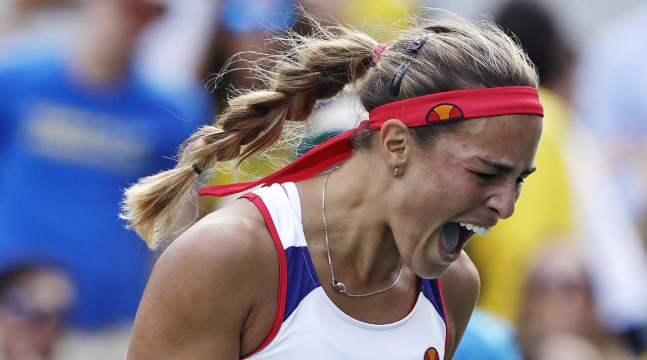Monica Puig, of Puerto Rico, celebrates after defeating Petra Kvitova, of the Czech Republic, during their semi-final round match at the 2016 Summer Olympics in Rio de Janeiro, Brazil, Friday, Aug. 12, 2016. (AP Photo/Charles Krupa)