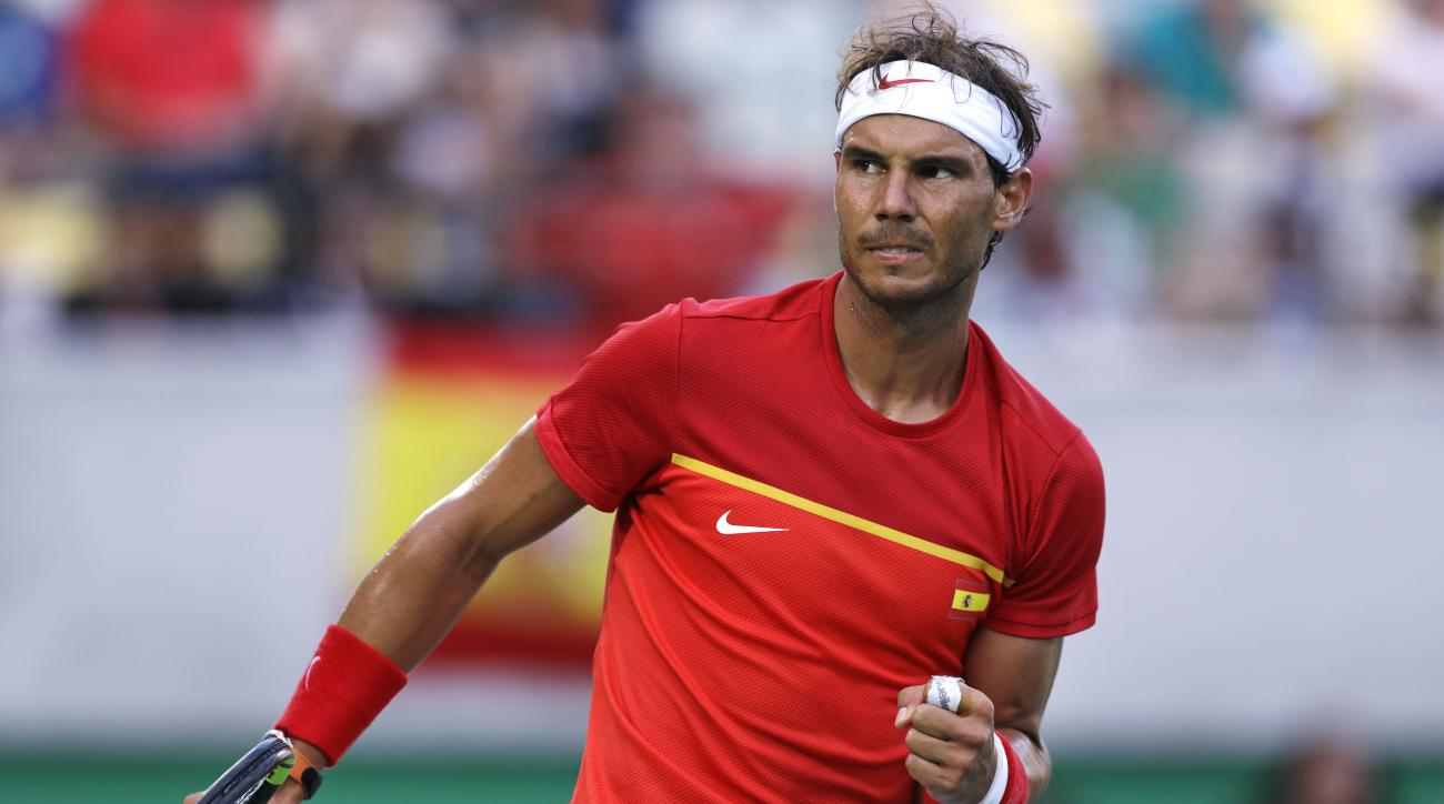 Rafael Nadal, of Spain, pumps his fist after winning a point against Thomaz Bellucci, of Brazil, during their quarter final round match at the 2016 Summer Olympics in Rio de Janeiro, Brazil, Friday, Aug. 12, 2016. Nadal defeated Bellucci in three sets. (A