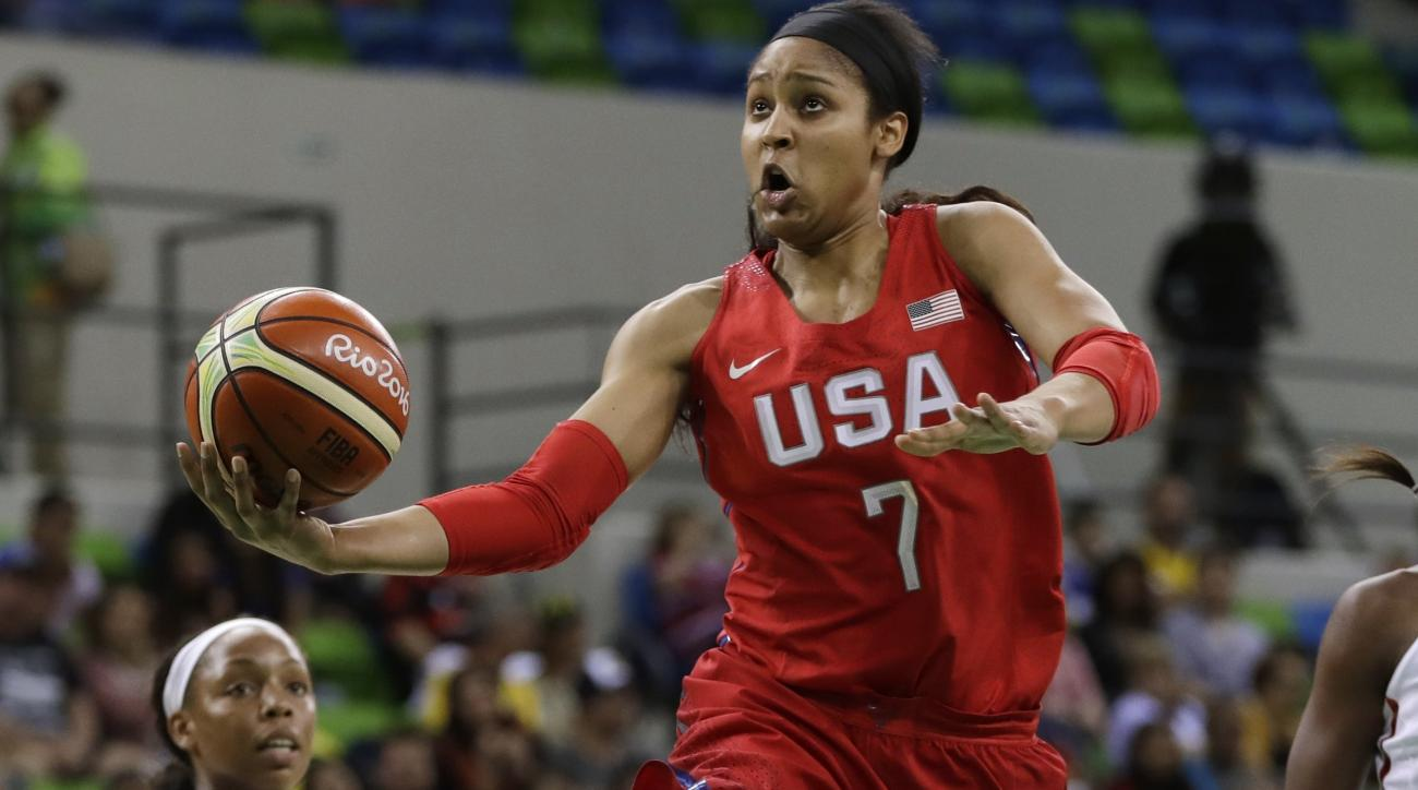 United States forward Maya Moore makes a layup during the first half of a women's basketball game against Canada at the Youth Center at the 2016 Summer Olympics in Rio de Janeiro, Brazil, Friday, Aug. 12, 2016. (AP Photo/Carlos Osorio)