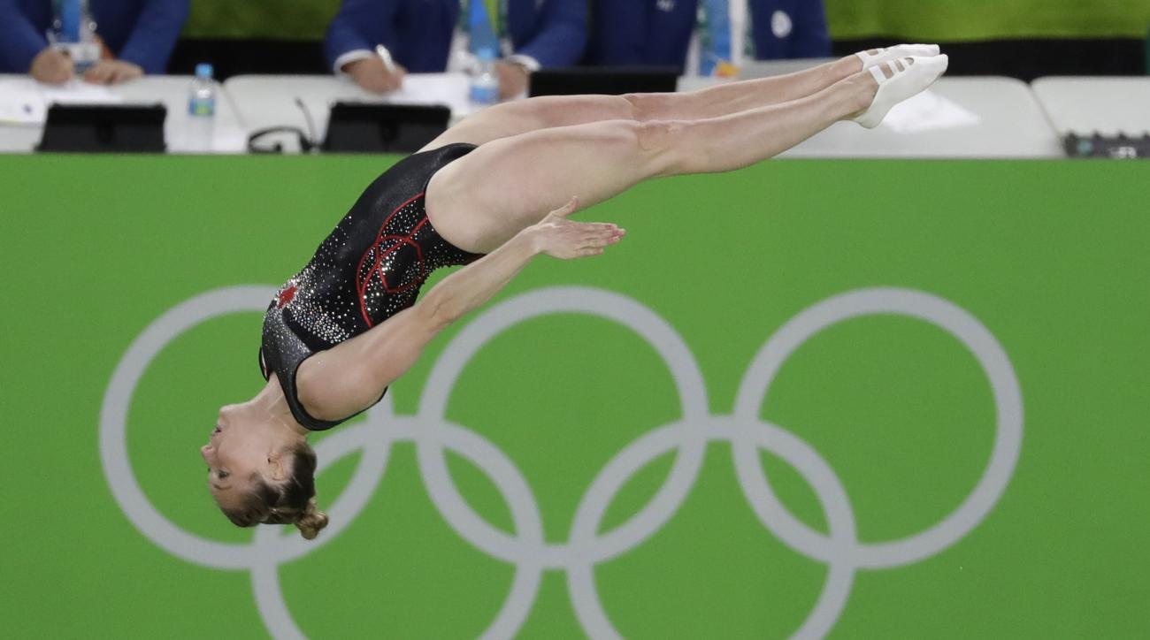 Canada's Rosannagh MacLennan performs during the women's trampoline final at the 2016 Summer Olympics in Rio de Janeiro, Brazil, Friday, Aug. 12, 2016. (AP Photo/Rebecca Blackwell)