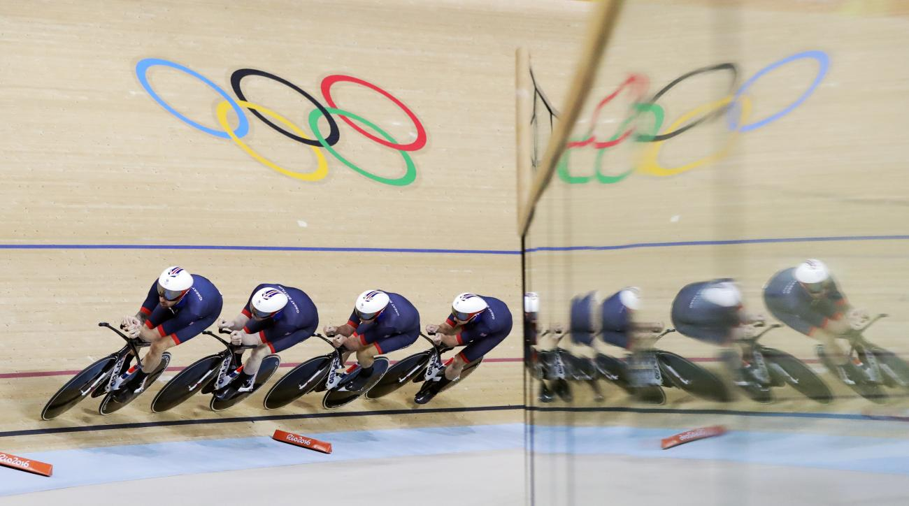 Great Britain's team competes to set a new world record in the Men's team pursuit first round at the Rio Olympic Velodrome during the 2016 Summer Olympics in Rio de Janeiro, Brazil, Friday, Aug. 12, 2016. (AP Photo/Pavel Golovkin)