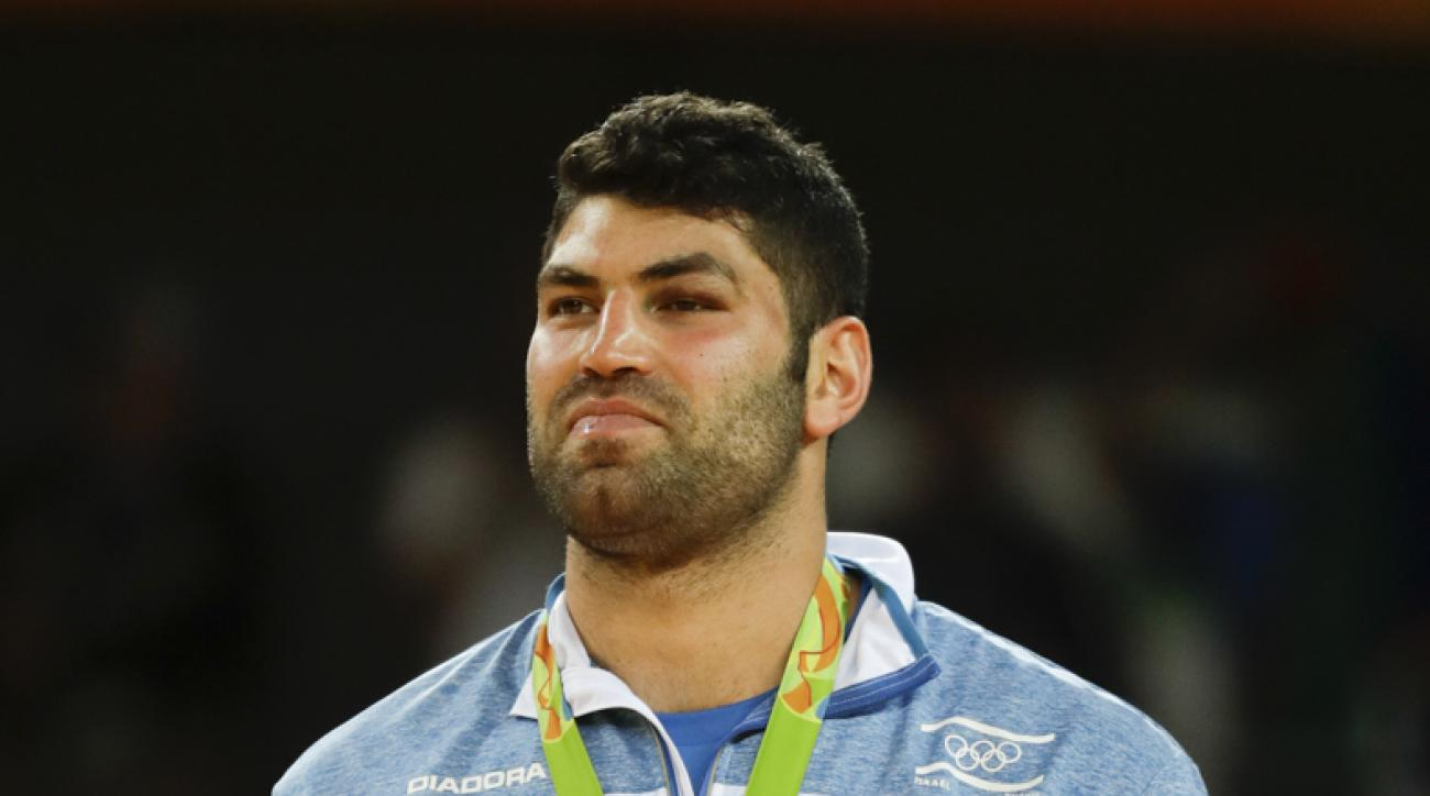 Bronze medalist Israel's Or Sasson attends the winners ceremony for the mens's over 100-kg judo competition at the 2016 Summer Olympics in Rio de Janeiro, Brazil, Friday, Aug. 12, 2016. (AP Photo/Markus Schreiber)