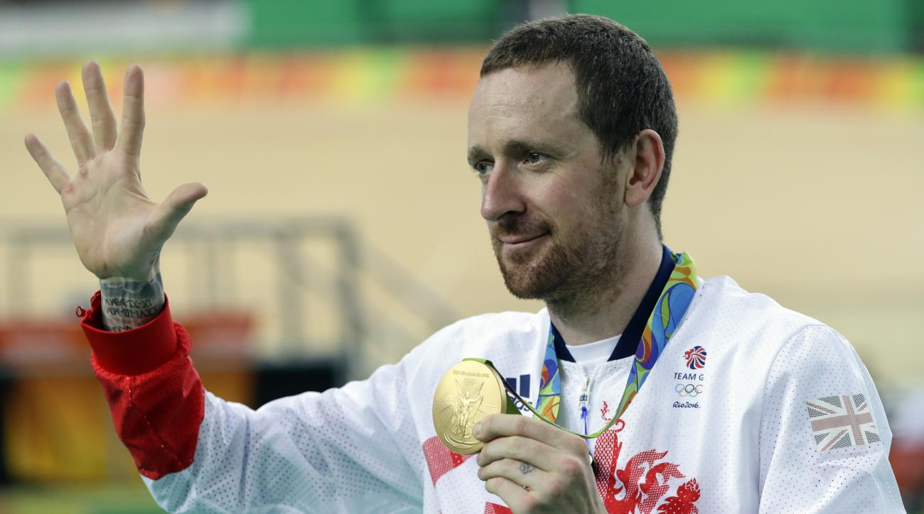 Gold medalist Bradley Wiggins of Britain poses on the podium of the Men's team pursuit final at the Rio Olympic Velodrome during the 2016 Summer Olympics in Rio de Janeiro, Brazil, Friday, Aug. 12, 2016. (AP Photo/Pavel Golovkin)