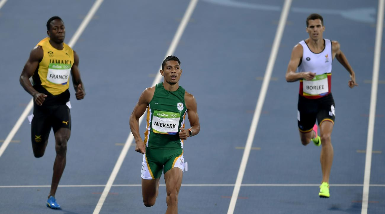 South Africa's Wayde van Niekerk, center, Jamaica's Javon Francis, left, and Belgium's Jonathan Borlee compete in a men's 400-meter heat during the athletics competitions of the 2016 Summer Olympics at the Olympic stadium in Rio de Janeiro, Brazil, Friday