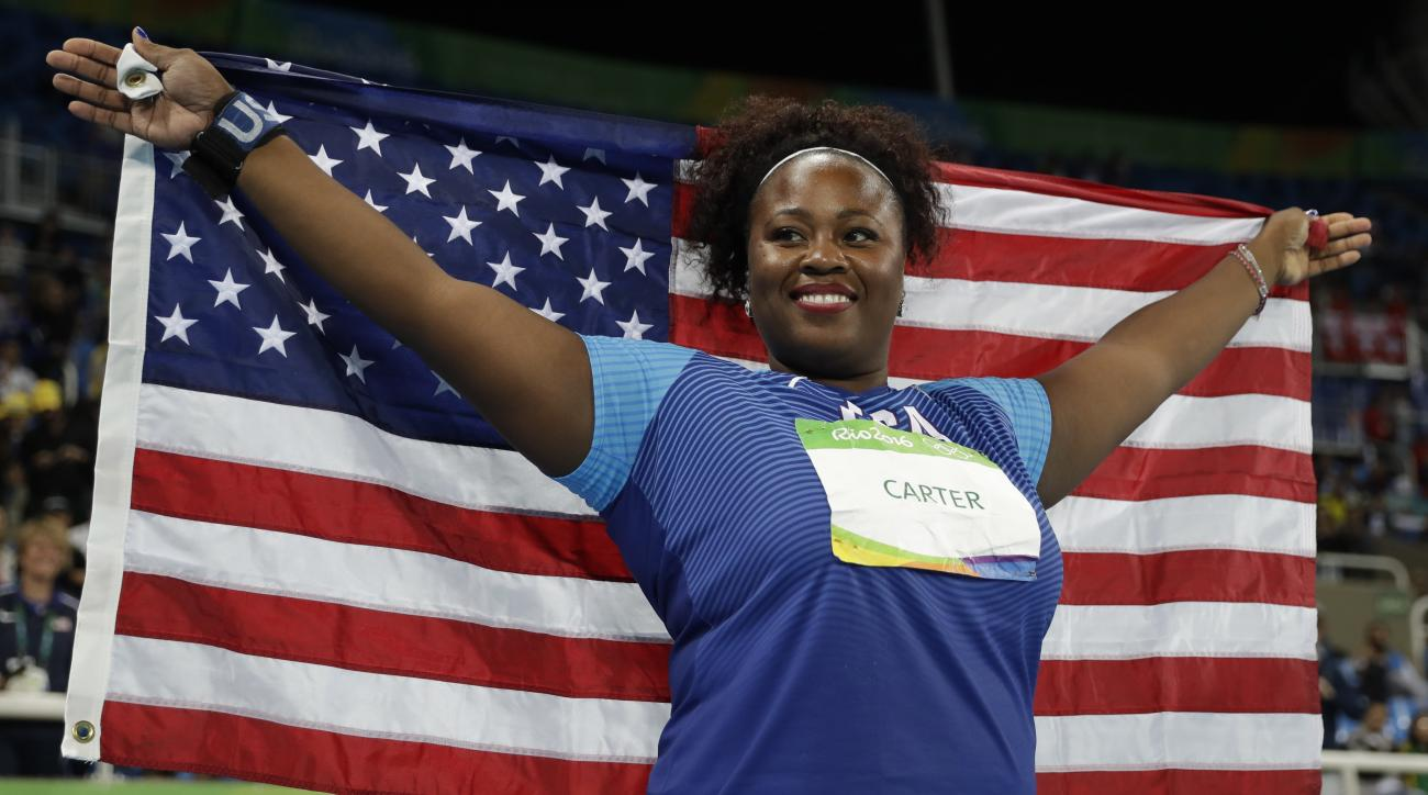 United States' Michelle Carter celebrates winning the gold medal in the women's shot put during the athletics competitions of the 2016 Summer Olympics at the Olympic stadium in Rio de Janeiro, Brazil, Friday, Aug. 12, 2016. (AP Photo/Matt Dunham)