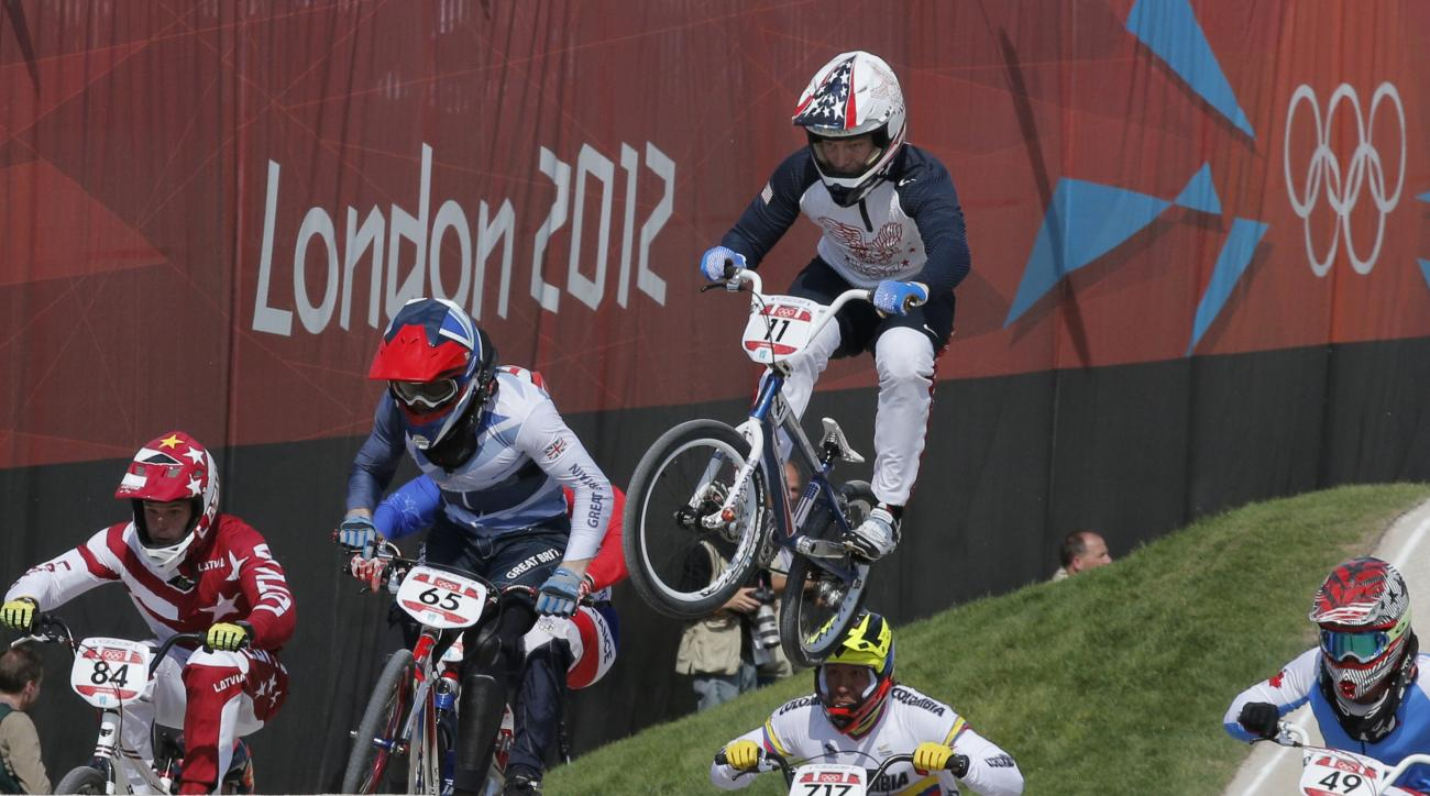 FILE - In this Aug. 9, 2012, file photo, United States' Connor Fields (11) leads the competition in a BMX cycling men's quarterfinal run during the 2012 Summer Olympics in London. Fields is back from a hand injury that derailed a promising BMX season. But