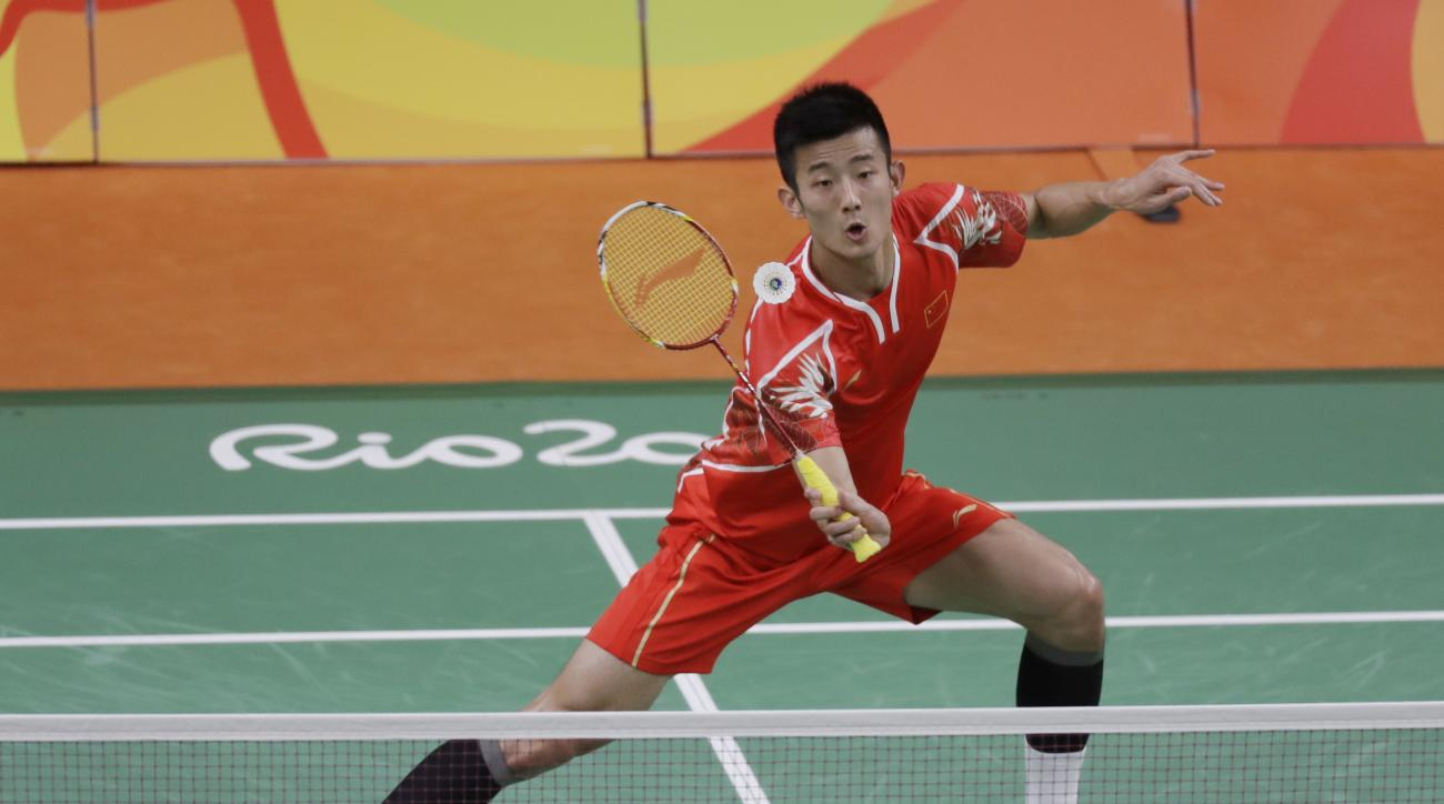 China's Chen Long returns a shot to Poland's Adrian Dziolko during a Men's single match at the 2016 Summer Olympics in Rio de Janeiro, Brazil, Saturday, Aug. 13, 2016. (AP Photo/Kin Cheung)