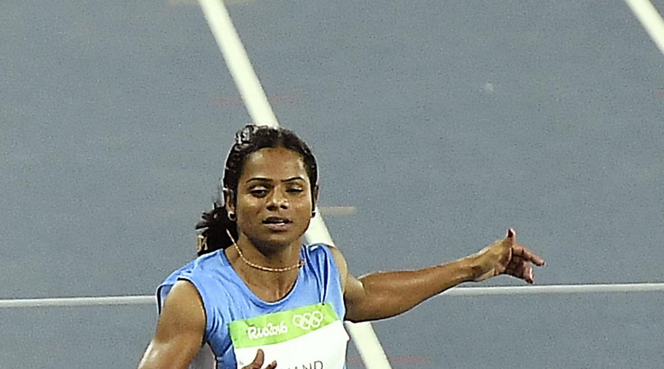India's Dutee Chand crosses the line in a women's 100-meter first round heat during the athletics competitions of the 2016 Summer Olympics at the Olympic stadium in Rio de Janeiro, Brazil, Friday, Aug. 12, 2016. (AP Photo/Martin Meissner)