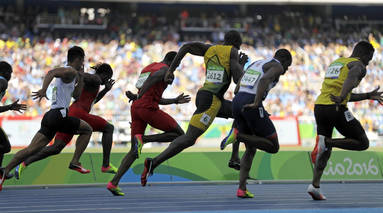 Jamaica's Usain Bolt, center, competes in a men's 100-meter heat during the athletics competitions of the 2016 Summer Olympics at the Olympic stadium in Rio de Janeiro, Brazil, Saturday, Aug. 13, 2016. (AP Photo/Jae C. Hong)