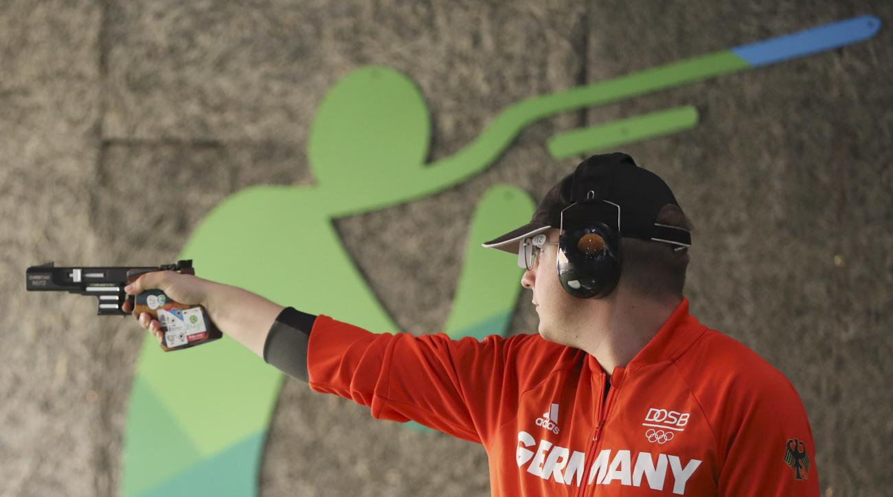 Christian Reitz of Germany competes during the men's 25 meter rapid fire pistol qualification at Olympic Shooting Center at the 2016 Summer Olympics in Rio de Janeiro, Brazil, Saturday, Aug. 13, 2016. Reitz won the gold medal. (AP Photo/Eugene Hoshiko)
