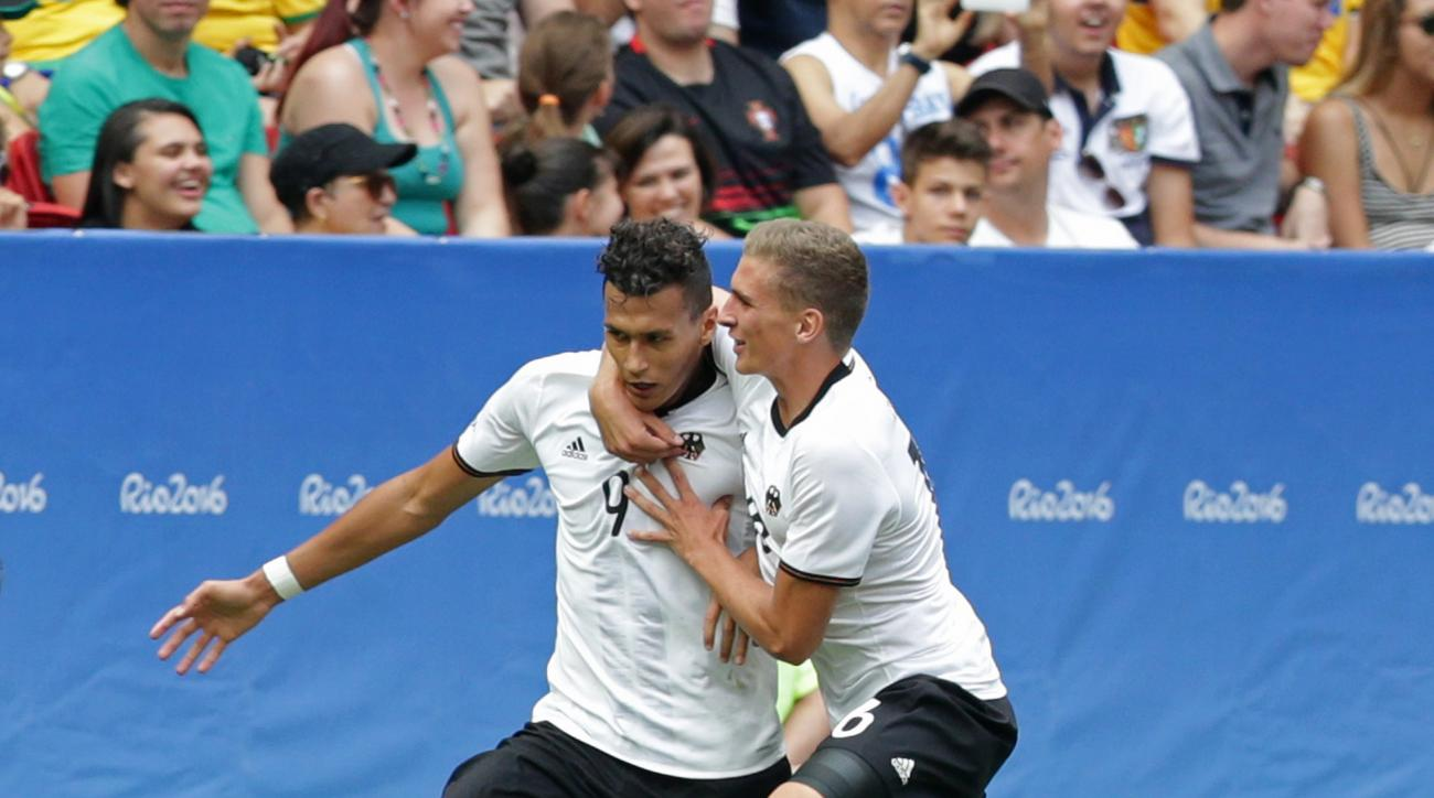 Germany's Davie Selke, left, celebrates scoring his side's 3rd goal during a quarter-final match of the men's Olympic football tournament between Germany and Portugal at the National Stadium, in Brasilia, Brazil, Saturday, Aug. 13, 2016. (AP Photo/Eraldo