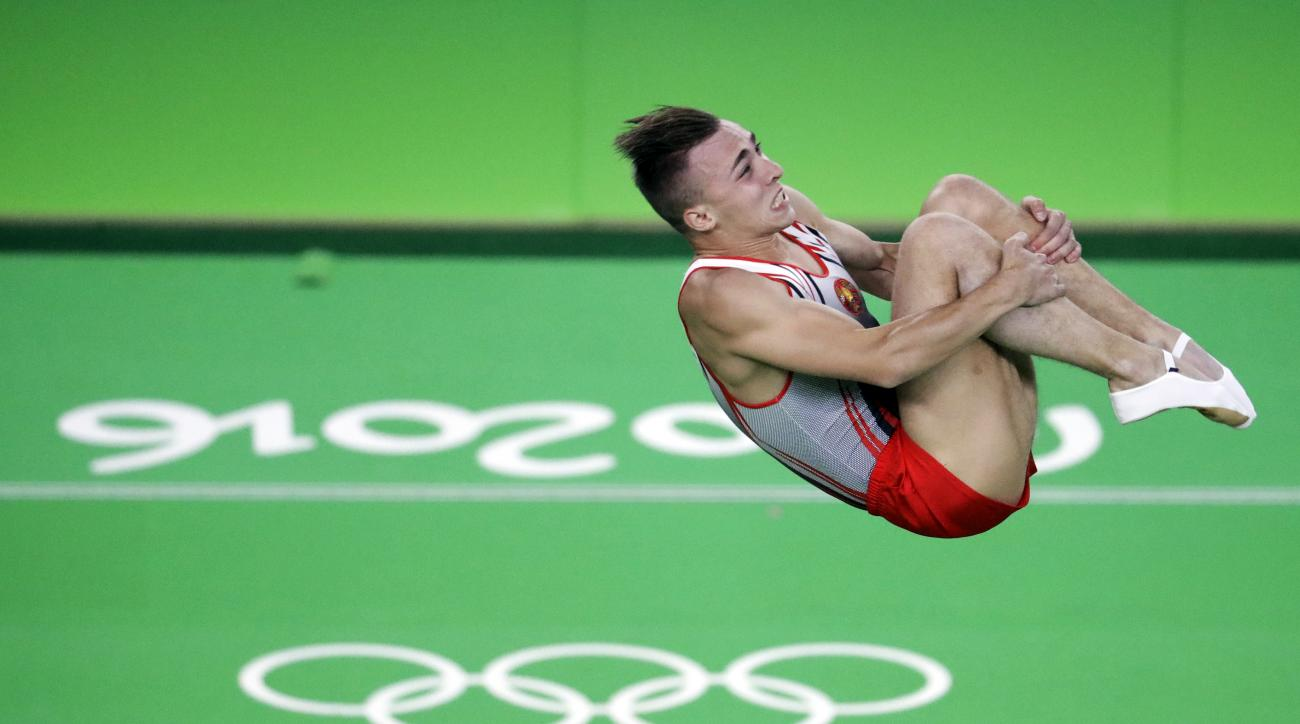 Belarus' Uladzislau Hancharou performs during the men's trampoline final at the 2016 Summer Olympics in Rio de Janeiro, Brazil, Saturday, Aug. 13, 2016. (AP Photo/Julio Cortez)
