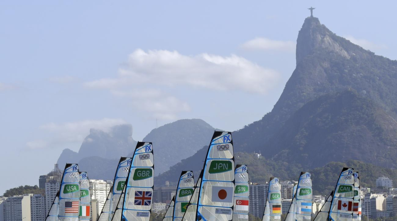 Paris Henken and teammate Helena Scutt, of the United States, left, sail during their 49er FX women race at the 2016 Summer Olympics in Rio de Janeiro, Brazil, Saturday, Aug. 13, 2016. (AP Photo/Gregorio Borgia)
