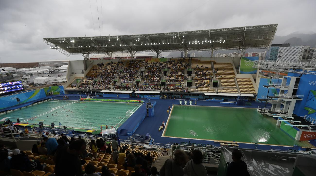 FILE - In this Aug. 10, 2016 file photo, the water of the diving pool at right appears a murky green as the water polo pool at left appears a greener color than the previous day during a preliminary round match between United States and France in the Mari