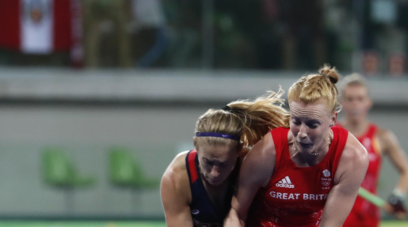 United States' Katie Bam, left, fights for the ball with Britain's Nicola White during a women's field hockey match at the 2016 Summer Olympics in Rio de Janeiro, Brazil, Saturday, Aug. 13, 2016. (AP Photo/Dario Lopez-Mills)