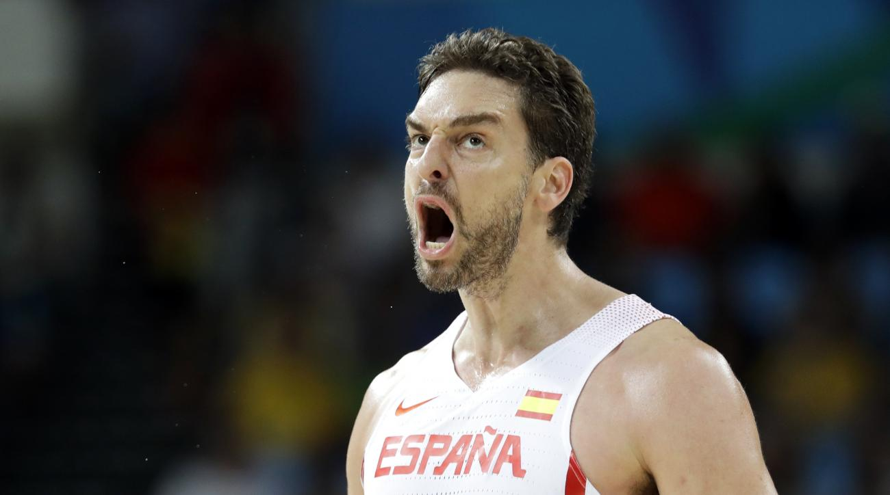 Spain's Pau Gasol (4) reacts after making a basket during a basketball game against Lithuania at the 2016 Summer Olympics in Rio de Janeiro, Brazil, Saturday, Aug. 13, 2016. (AP Photo/Charlie Neibergall)