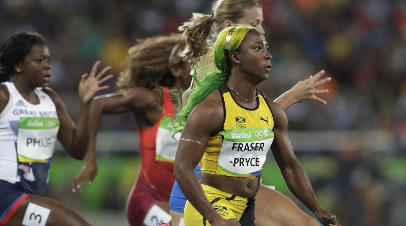 Jamaica's Shelly-Ann Fraser-Pryce competes in a women's 100-meter semifinal during the athletics competitions of the 2016 Summer Olympics at the Olympic stadium in Rio de Janeiro, Brazil, Saturday, Aug. 13, 2016. (AP Photo/Kirsty Wigglesworth)