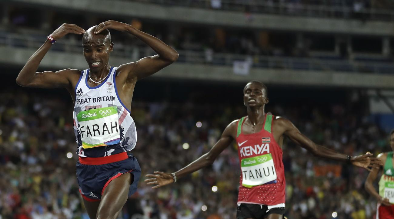 Britain's Mo Farah, left, and Kenya's silver medal winner Paul Kipngetich Tanui compete in the men's 10,000-meter final during the athletics competitions in the Olympic stadium of the 2016 Summer Olympics in Rio de Janeiro, Brazil, Saturday, Aug. 13, 2016