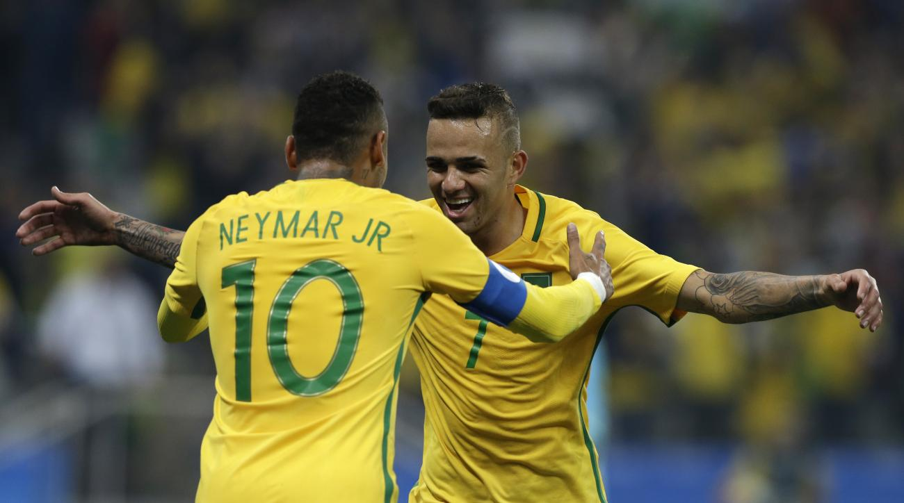 Brazil's Luan, right, celebrates with teammate Neymar after scoring his team's second goal during a quarter-final match of the men's Olympic football tournament between Brazil and Colombia in Sao Paulo, Brazil, Saturday Aug. 13, 2016.(AP Photo/Leo Correa)