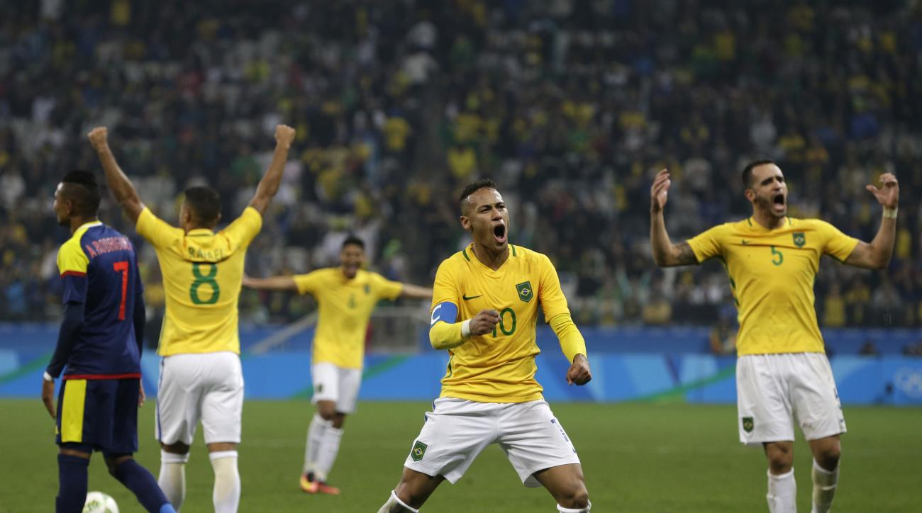 Brazil's Neymar, center, Rafael Alcantara, second from left, and Renato Augusto, right, celebrate at the end of a quarter-final match of the men's Olympic football tournament against Colombia in Sao Paulo, Brazil, Saturday Aug. 13, 2016. Brazil won 2-0 an