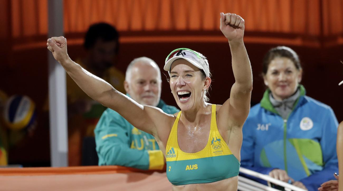 Australia's Louise Bawden celebrates after beating Poland during a women's beach volleyball round of 16 match at the 2016 Summer Olympics in Rio de Janeiro, Brazil, Saturday, Aug. 13, 2016. (AP Photo/Marcio Jose Sanchez)