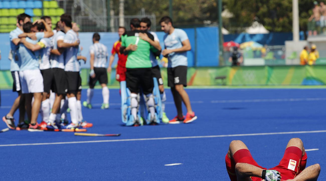 Spain's Miguel Delas lies on the pitch after his team lost to Argentina during a men's field hockey quarter final match at the 2016 Summer Olympics in Rio de Janeiro, Brazil, Sunday, Aug. 14, 2016. (AP Photo/Dario Lopez-Mills)
