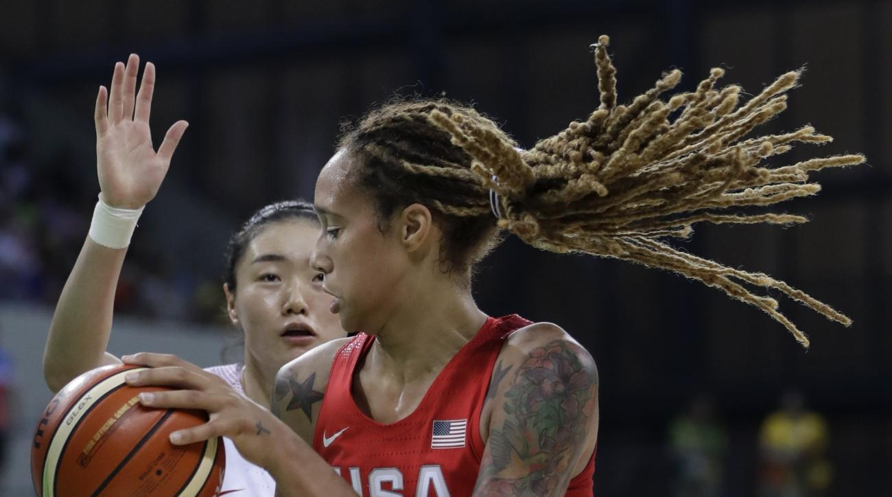 United States center Brittney Griner controls the ball under the basket during the first half of a women's basketball game against China at the Youth Center at the 2016 Summer Olympics in Rio de Janeiro, Brazil, Sunday, Aug. 14, 2016. (AP Photo/Carlos Oso