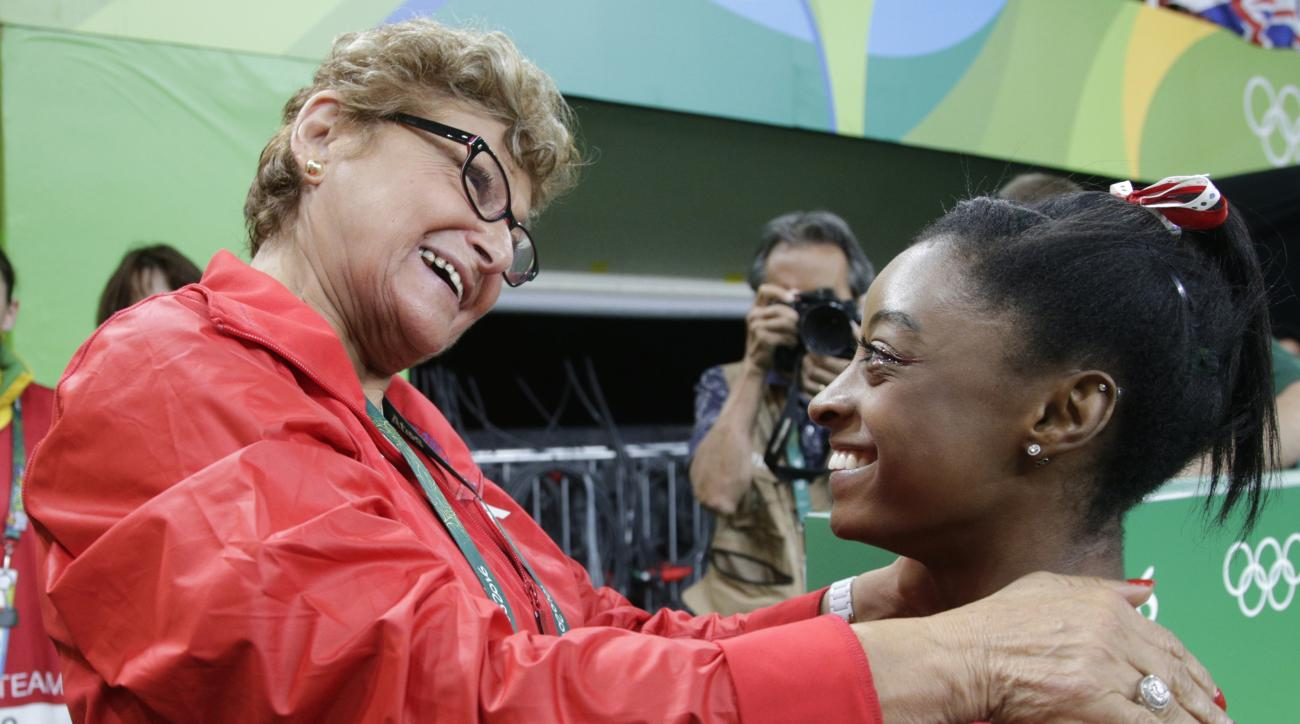 United States' Simone Biles is congratulated by U.S. gymnastics team coordinator Martha Karolyi after she won the gold for vault during the artistic gymnastics women's apparatus final at the 2016 Summer Olympics in Rio de Janeiro, Brazil, Sunday, Aug. 14,