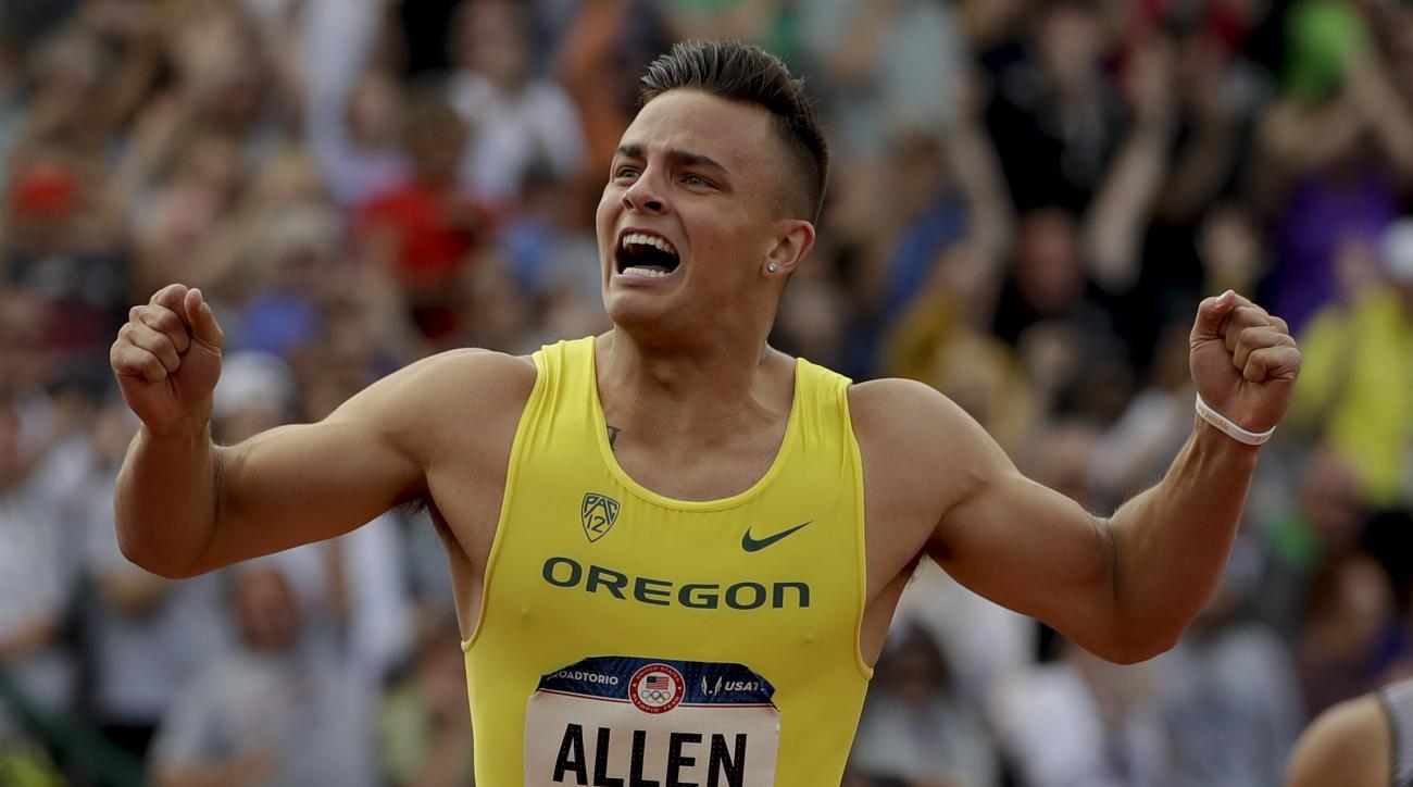 FILE - In this July 9, 2016 file photo, Devon Allen celebrates his win in the finals of the men's 110-meter hurdles at the U.S. Olympic Track and Field trials in Eugene Oregon. Allen, also a player for the Oregon Ducks football team, will make his Olympic