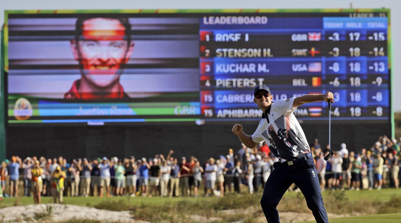 Justin Rose of Great Britain, wins the gold medal during the final round of the men's golf event at the 2016 Summer Olympics in Rio de Janeiro, Brazil, Sunday, Aug. 14, 2016. (AP Photo/Chris Carlson)