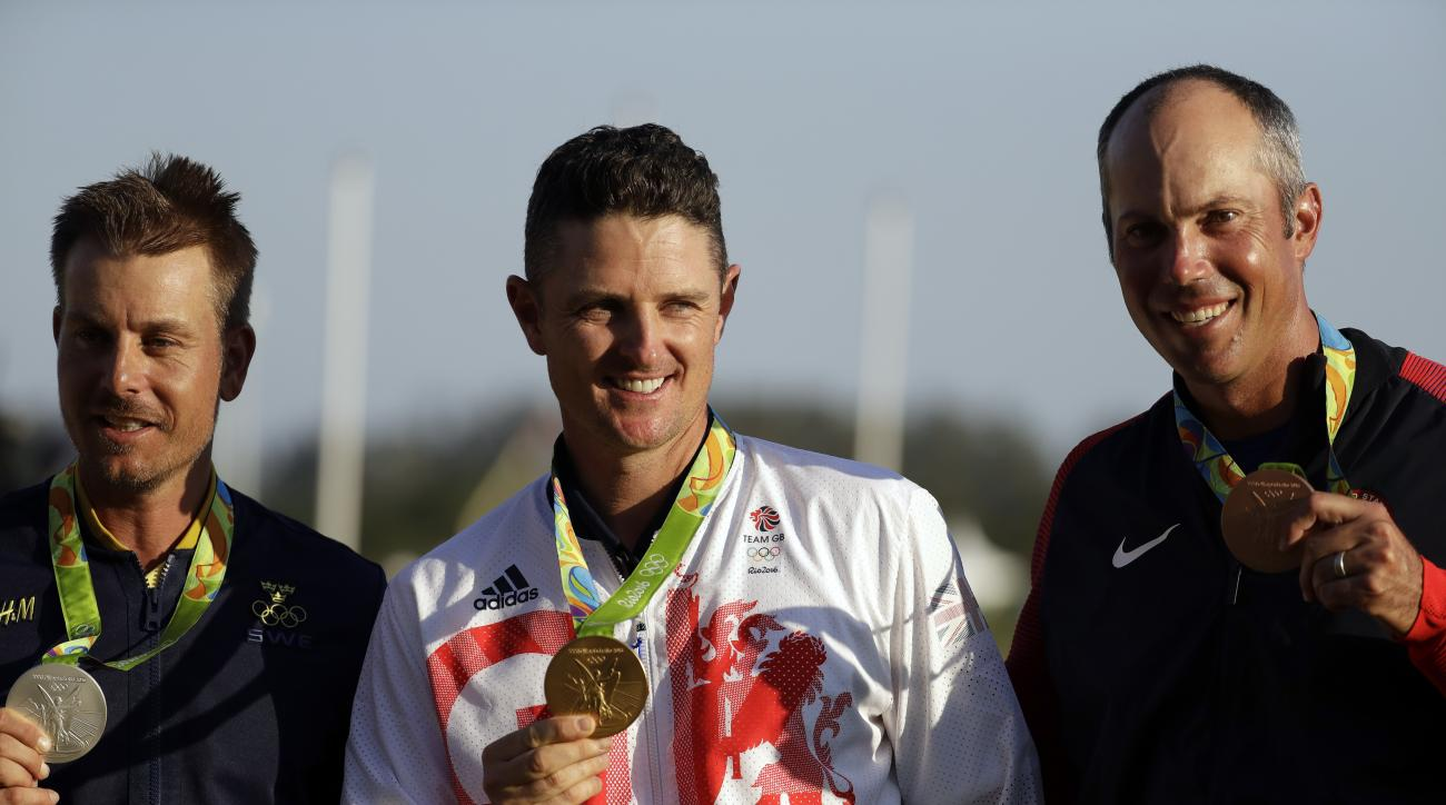 The medalists are seen from left to right, silver medalist Henrik Stenson of Sweden, gold medalist Justin Rose of Great Britain, and bronze medalist Matt Kuchar of the, United States, after the final round of the men's golf event at the 2016 Summer Olympi
