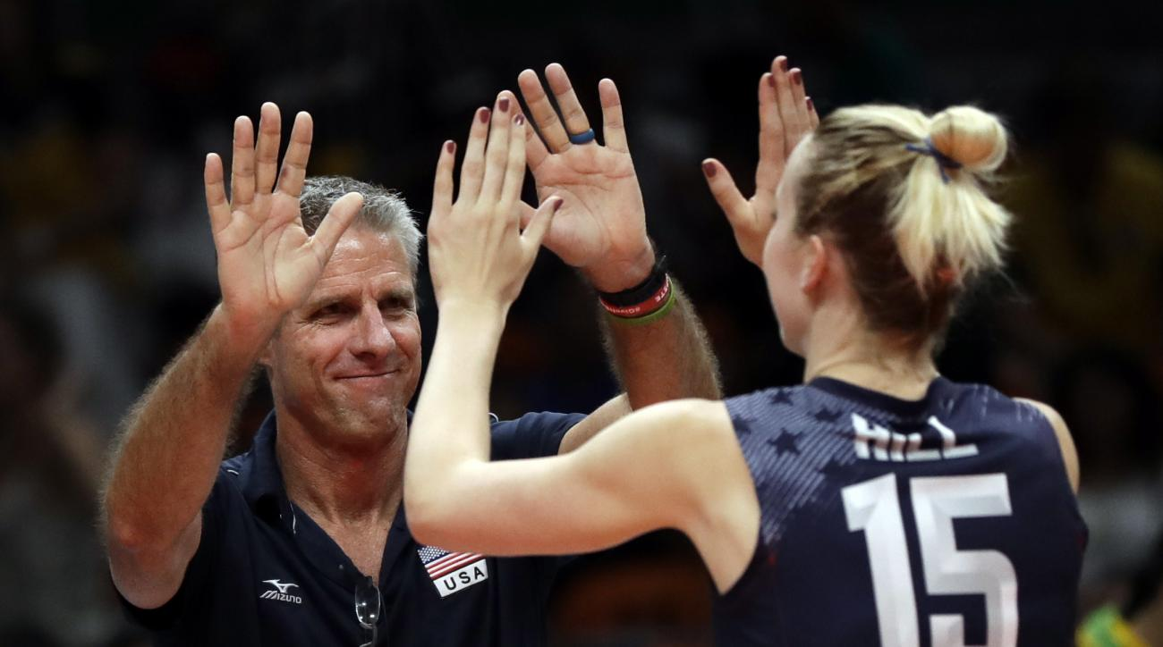 United States head coach Karch Kiraly celebrates with Kim Hill after a women's preliminary volleyball match against China at the 2016 Summer Olympics in Rio de Janeiro, Brazil, Sunday, Aug. 14, 2016. (AP Photo/Matt Rourke)