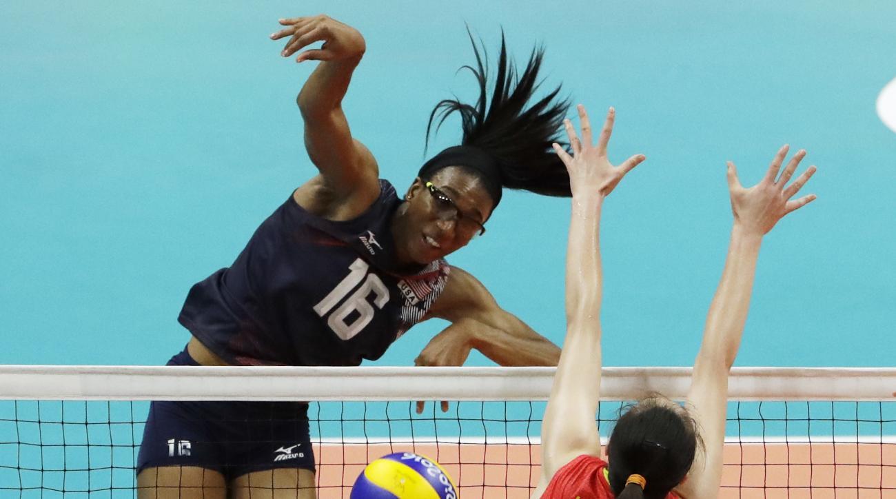 United States' Foluke Akinradewo (16) spikes the ball as China's Hui Ruoqi (12) defends during a women's preliminary volleyball match at the 2016 Summer Olympics in Rio de Janeiro, Brazil, Sunday, Aug. 14, 2016. (AP Photo/Matt Rourke)
