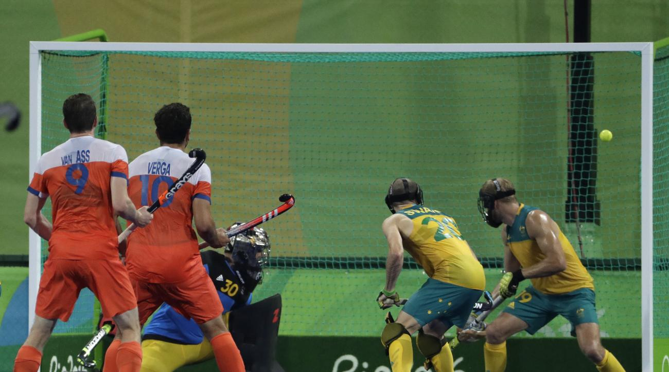 Australian players Mathew Swann and his teammate Bob da Voogd, right, look to a scored ball enter their net during a men's field hockey quarterfinal match against Netherlands at 2016 Summer Olympics in Rio de Janeiro, Brazil, Sunday, Aug. 14, 2016. (AP Ph