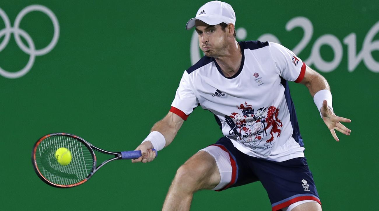 Andy Murray, of England, returns to Juan Martin del Potro, of Argentina, during their gold medal match at the 2016 Summer Olympics in Rio de Janeiro, Brazil, Sunday, Aug. 14, 2016. (AP Photo/Charles Krupa)