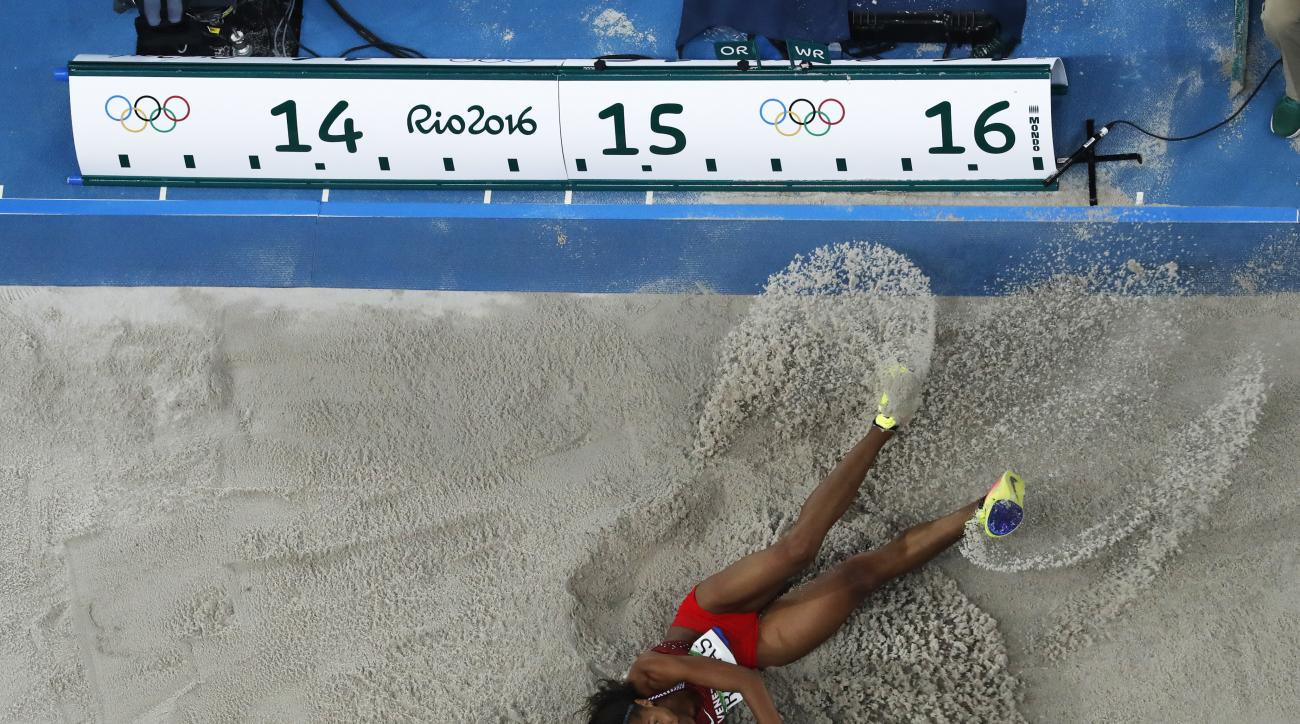 Venezuela's Yulimar Rojas lands during the triple jump finals at the athletics competitions of the 2016 Summer Olympics at the Olympic stadium in Rio de Janeiro, Brazil, Sunday, Aug. 14, 2016. (AP Photo/Morry Gash)