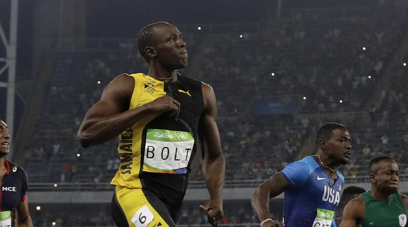 Jamaica's Usain Bolt celebrates as he competes beside United States' Justin Gatlin in the men's 100-meter final during the athletics competitions of the 2016 Summer Olympics at the Olympic stadium in Rio de Janeiro, Brazil, Sunday, Aug. 14, 2016. (AP Phot
