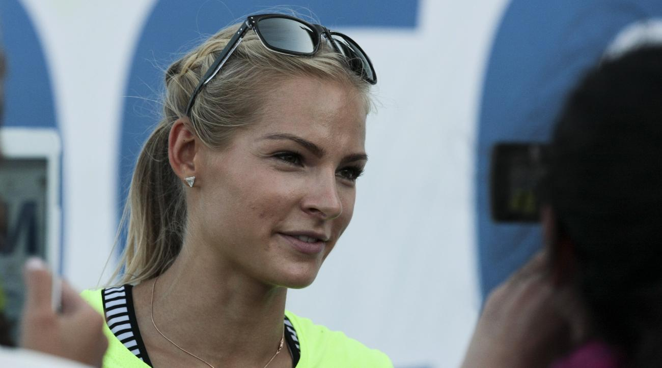 FILE - In this June 20, 2016 file photo, Russia's long jumper Darya Klishina speaks at the national track and field championship in Cheboksary, Russia. The lone Russian track and field athlete at the Olympics has won her appeal to compete at the Rio de Ja