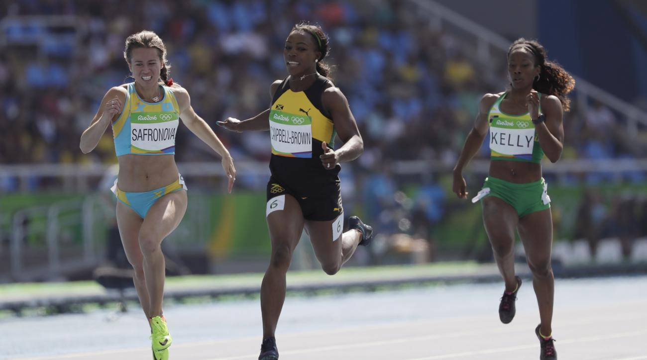 Jamaica's Veronica Campbell-Brown, center, British Virgin Islands's Ashley Kelly, right, and Kazakhstan's Olga Safronova compete in a women's 200-meter heat during the athletics competitions of the 2016 Summer Olympics at the Olympic stadium in Rio de Jan
