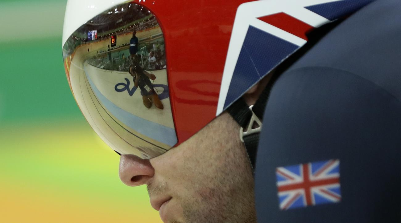 Mark Cavendish of Britain gets ready to compete in the men's cycling omnium time trial at the Rio Olympic Velodrome during the 2016 Summer Olympics in Rio de Janeiro, Brazil, Monday, Aug. 15, 2016. (AP Photo/Pavel Golovkin)