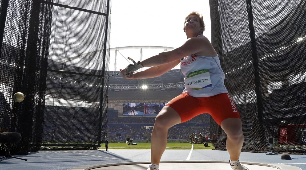 Poland's gold medal winner Anita Wlodarczyk makes her world record throw in the women's hammer throw final during the athletics competitions of the 2016 Summer Olympics at the Olympic stadium in Rio de Janeiro, Brazil, Monday, Aug. 15, 2016. (AP Photo/Mat