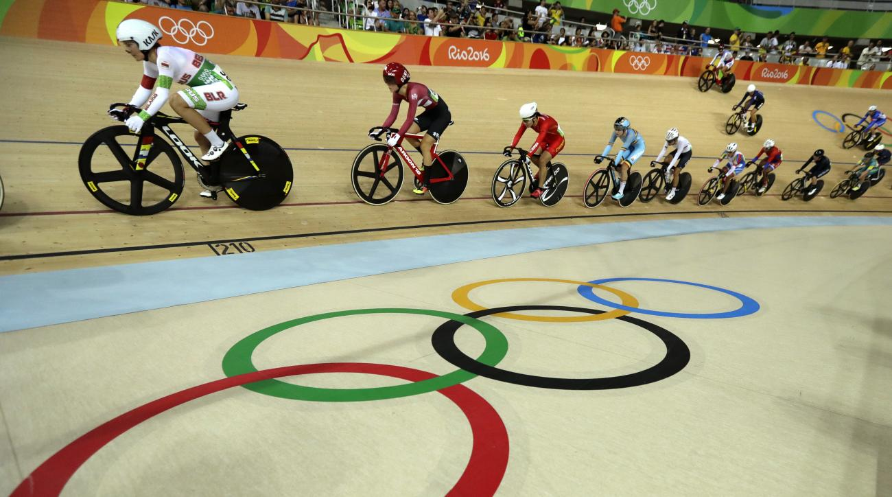Cyclists compete in the women's cycling omnium scratch race at the Rio Olympic Velodrome during the 2016 Summer Olympics in Rio de Janeiro, Brazil, Monday, Aug. 15, 2016. (AP Photo/Pavel Golovkin)