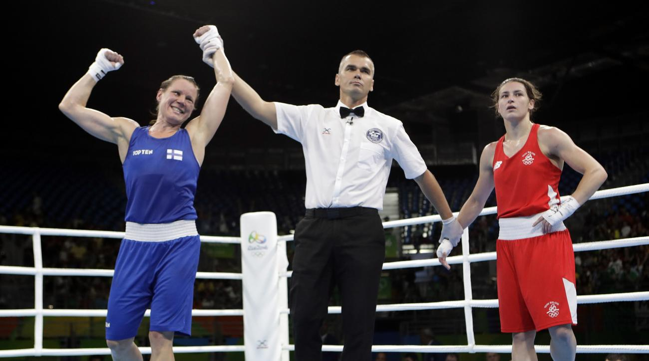Finland's Mira Potkonen, left, reacts as she won a women's lightweight 60-kg quarterfinals boxing match against Ireland's Katie Taylor at the 2016 Summer Olympics in Rio de Janeiro, Brazil, Monday, Aug. 15, 2016. (AP Photo/Frank Franklin II)